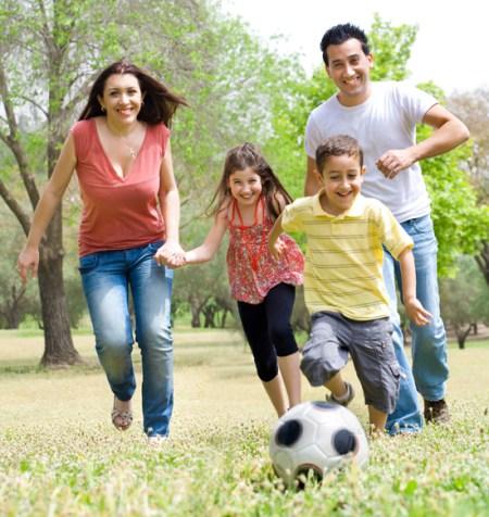 Happy family run at park